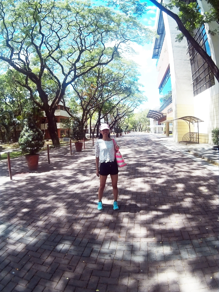 Hi Red Brick Road! (Running Shoes and cap from Nike, White top from Forever 21, Black shorts from H&M, Striped purse from Michael Kors)